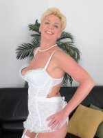 Taylor Lynn - 47 year old Taylor Lynn strips off her hite lace and spreads her legs