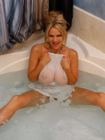 Kelly hops in the bath and her white dress turns see thru.