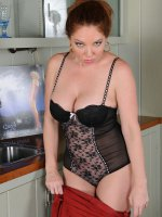 Kiki DAire - Busty auburn haired Kiki D'Aire showing off her 39 year old body