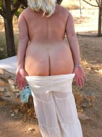 Busty mature blonde Dana showing her mature tits outdoors