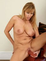 Check out this mature babe as she inserts a huge toy in to her tight milf pussy