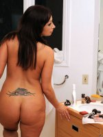 Flirty voluptuous woman flaunts her delectable mature body in front of the mirror