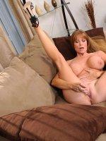 Seductive brunette Darla Crane plunges a glass dildo deep inside of her cougar fuck hole