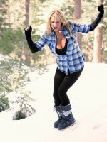 Kelly runs around topless in the snow, she gets to the cabin and gets her pussy all warmed up.