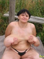 Mature with big mature tits outdoors