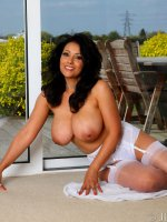 Danica Collins in white lace and nylon stockings and lingerie