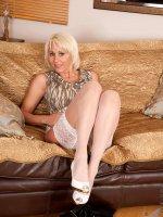 Hot blonde milf Jan Burton strokes her slippery pink cougar pussy