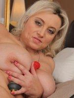 Sindy Huga - 44 year old Sindy Huga plants a large red dildo into her mature box
