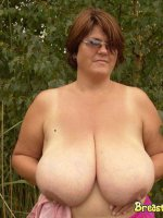 Mature babe with big mature tits outdoors
