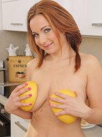 Jessica Red - Red headed mature Jessica Red plays around with her big melons