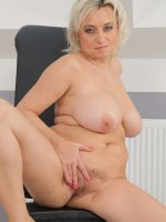 Sindy Huga - Blonde and nicely busty Sindy Huga spreads open her mature legs