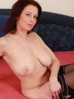 Busty housewife Carol spreads her black stocking clad legs in here