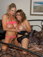 Kelly and Sienna West rub on each others tits and kiss in pink and black fishnets.