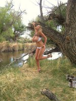 Kelly gets naked outdoors and ends up with a load of cum on her tits.