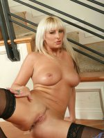 Dazzling Anilos beauty exposes her massive mature tits and spreads her ass cheeks wide