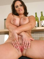 Busty MILF Olarita has fun with her mature tits after her housework