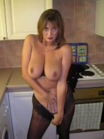 Busty housewife posing in the kitchen