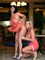 Kelly and Sienna West lick on each others tits and pussies in coral see thru dresses.