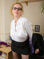 Blonde Taya shows off her massive breasts in these office pics