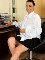 Leona SweetHot brunette secretary Leona Sweet unleashes her massive mams