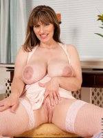 Busty milf spreads her pink pussy wide open on the table and flaunts her big mature tits