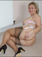 Amateur MILF Michelle showing her big mature tits and sexy legs in nylons