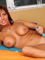 Cougar Tara Holiday shows off her big boobs and sexy landing strip pussy