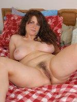 Tori strips to reavela big natural mature tits and a full bush