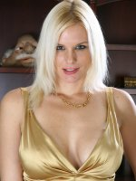 Elegant blonde MILF Slovanna slips off her dress to show off her mature tits